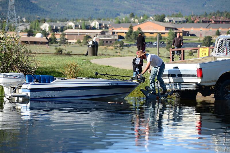 Walt Hester | Trail Gazette<br /> A boater drops his boat into Lake Estes on Saturday. Perhaps not the first thing a visitor thinks of for Estes Park, the lake offers plenty of recreational opportunities.