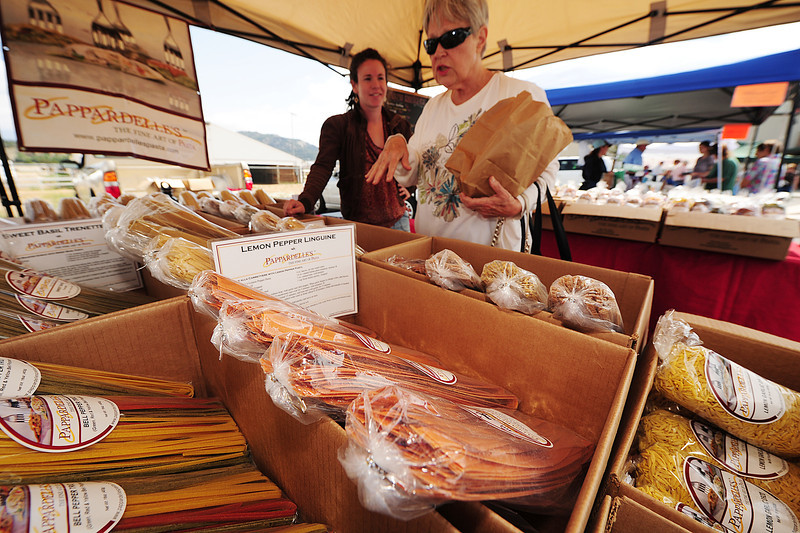 Walt Hester | Trail Gazette<br /> Chris Winokur of Estes Park, right, talks pasta with Jewel Campbell of Pappardelle's Fine Pasta at the Estes Valley Farmers' Market on Thursday. The Farmers' market opened for the season on Thursday and runs every Thursday morning through September with plenty of old favorites as well as a few new venders like Noosa Yogurt and Crepes a'Go-Go.