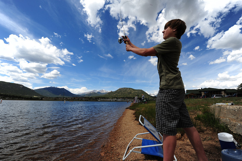 Walt Hester | Trail Gazette<br /> Ethan Igel casts his line into the lake during the fishing derby. The derby competition was divided into four age groups, as well as men and women.