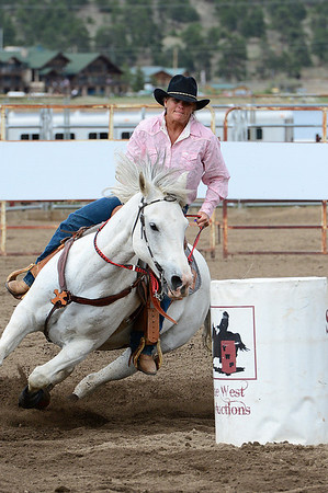 Walt Hester | Trail Gazette<br /> An experienced barrel racer leans around a barrel on her run on Saturday afternoon. Barrel racers spent the weekend at the Stanley Fairgrounds racing around barrels and weaving between poles on their mounts.