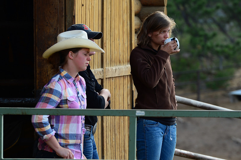 Walt Hester | Trail Gazette<br /> Cowgirls Keri Dinsmore, Rebecca Kulman and Lindsey Scherer begin their day at Sombrero Ranch on Tuesday. Work days begin well before 7 a.m. at the stables around Estes Park.
