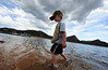 Walt Hester | Trail Gazette<br /> Parker Smithson, 5, of Estes Park, wades through Lake Estes on Saturday. Some children found alternatives to fishing to enjoy at the lake.