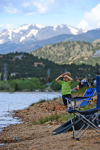 Walt Hester | Trail Gazette Rayce Lockman, 4, of Wellington, seems a bit impatient at the Lake Estes Fishing Derby on Saturday. Competitors commented that the fish seemed to know it was fishing derby day.