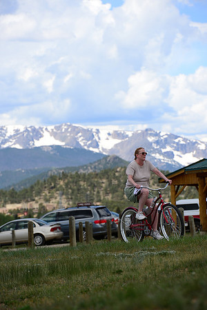 Walt Hester | Trail Gazette<br /> A cyclist cruises around the Lake Estes Trail on Saturday. Events around the lake, and even things to do around the marina was not limited to fishing or boating.
