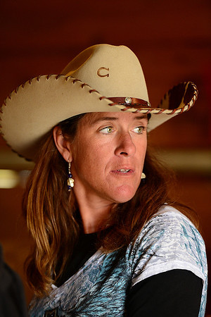 Walt Hester | Trail Gazette<br /> Barrel racer and riding coach Marti Rushton looks up to find friends at the fairgrounds on Saturday. Rushton coached several of the competitors at the barrel races.