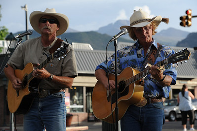 Walt Hester   Trail Gazette Mark Rashid and Cowboy Brad Fitch play Bond Park on Tuesday night. Cowboy Brad and friends will entertain visitors to the park throughout the summer.