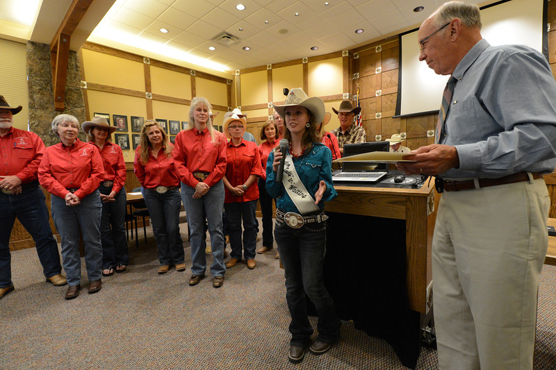 Walt Hester | Trail Gazette<br /> Rooftop Rodeo's Lady-In-Waiting Michelle Claypool accepts the proclamation of Rodeo Week from Mayor Bill Pinkham at the town board meeting on Tuesday. July 10-15 is Rooftop Rodeo Week in Estes Park.