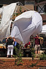 Walt Hester | Trail Gazette<br /> Patrons catch a tent picked up by the wind at the Scandinavian Midsummer Festival in Bond Park on Saturday. The same winds whipped flames at the Woodland Park Fire later in the day.