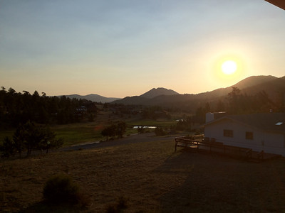 Hazy again Tuesday morning as the sun rises over Estes Park. Highs expected to reach the 90s with a slight chance of showers this evening.