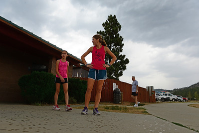 Walt Hester   Trail Gazette Lauren, 14, and Melissa Deitzer, 17, of Cincinnati, Ohio, restart their run in the rain on Wednesday. The first measurable rain in weeks fell on Estes Park, with more in Friday's forecast