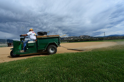 Walt Hester   Trail Gazette Denny Ground kicks up dust while dragging the infield at the Stanley Ballfields on Wednesday as stormy clouds gather. Estes Park and much of Colorado are hoping for rain as fires continue burn and new fires start.