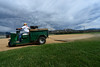 Walt Hester | Trail Gazette<br /> Denny Ground kicks up dust while dragging the infield at the Stanley Ballfields on Wednesday as stormy clouds gather. Estes Park and much of Colorado are hoping for rain as fires continue burn and new fires start.