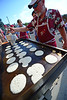 Walt Hester | Trail-Gazette<br /> A member of the Knights of Columbus prepare pancakes for visitors to the annual Independence Day Pancake Breakfast at Our Lady of the Mountains Catholic Church on Wednesday.