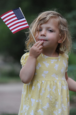 Walt Hester | Trail-Gazette<br /> Camber Reaume, 2, of Fort Collins seems thoughtful before the annual Patriotic Copncert at Performance Park on Wednesday evening. The Village Band entertained a big crowd with patriotic music for the Independence Day holiday.