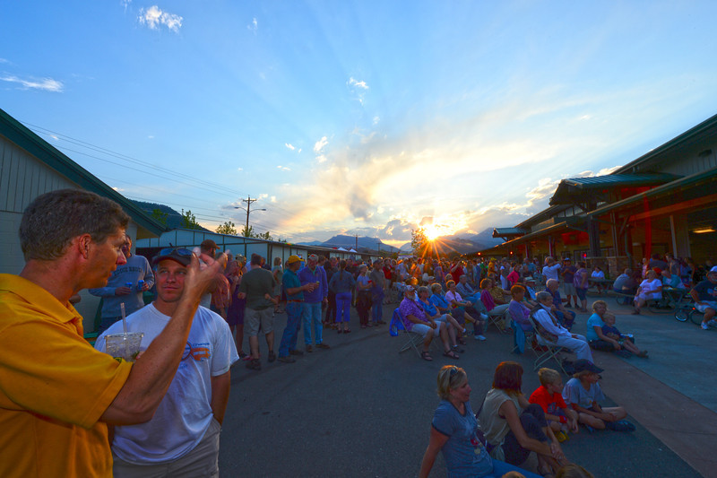 Walt Hester | Trail-Gazette<br /> A spectacular sunset ends Tuesday and the Community Block Party at the Stanley Fairgrounds. The event was a fundraiser for victims of the Woodland Heights Fire.