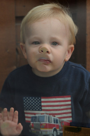 Walt Hester | Trail-Gazette<br /> Evan Gipp, 1, presses his face against a glass door on Wednesday.
