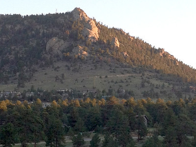 Sunrise colors Prospect Mountain and slowly warms Estes Park. The weather pattern of the week continues with highs in the mid 80s today and afternoon showers.