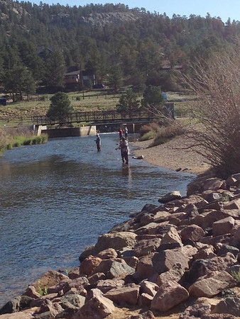 Fishermen try their luck under sunny skies Monday morning on the Big Thompson River just below Olympus Dam. Estes Park can expect more sunshine throughout the day with a chance of afternoon thundershowers.