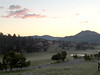 The rising sun colors clouds over a chilly Estes Park on Thursday. While cool to start, Thursday's high should touch 80, with a slight chance of rain this afternoon.