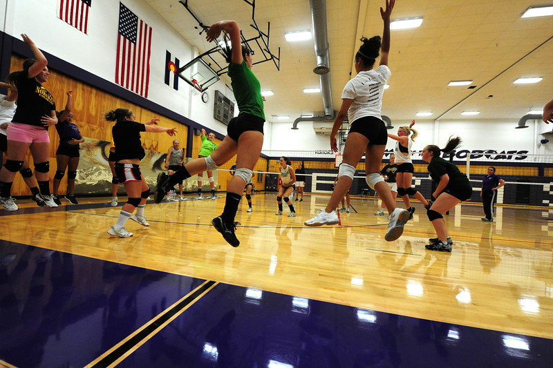 Walt Hester | Trail Gazette<br /> Ladycats volleyball players work on timing during the Wednesday aftrenoon session at the high school. The U of Wyo coaches and players gave the Estes Park girls plenty to work on.