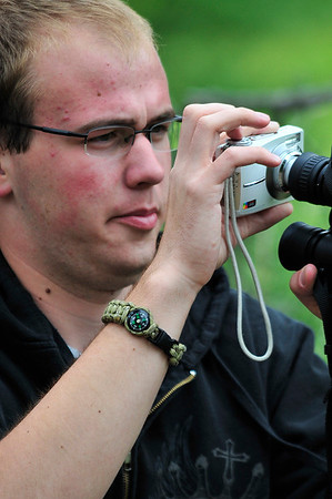 Walt Hester | Trail Gazette<br /> A park visitor improvises a telephoto lens with binoculars on the park's west side. Photographers often say the best camera is the one with you.