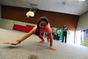 Walt Hester   Trail Gazette<br /> Maria Rojas, 9, scampers across the old elementary school gym like a black bear on Wednesday. The Kids Cafe offerts learning activities for children, as well as a nutricious lunch.