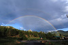 Walt Hester | Trail Gazette<br /> A double rainbow arches across the sky and over the very top of Mount Olympus on Wednesday. The cloudy skies produced a little rain before breaking up in the evening.