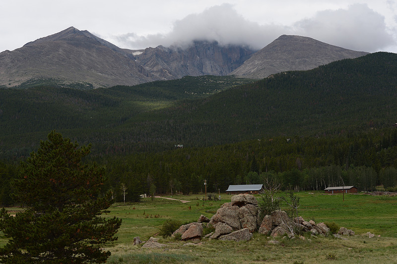 Walt Hester | Trail Gazette<br /> Clouds curl over the top of Longs Peak on Wednesday. Weather changes quickly and can't be seen from the Diamond, Longs' east face, making climbing challenging, if not dangerous.