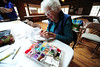 Walt Hester | Trail Gazette<br /> Linda Eller works on her needlepoint at the Hilltop Housenear Allenspark on Wednesday. The annual Hilltop Guild Festival and Bazzar features a great deal of handmade items and raises money for scholarships.