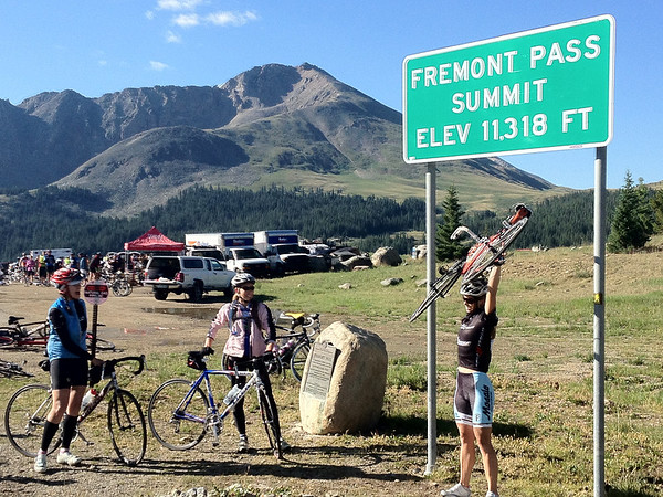 Walt Hester | Trail Gazette<br /> Riders celebrate cresting Fremont Pass andthe Continental Divide, for the second time in three days on Monday. The ride started in Copper Mountain Resort on the third day, making the pass climb about 1,600 feet in 11 miles of climbing.