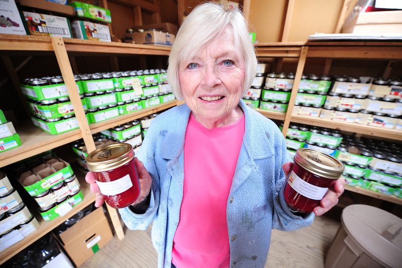 Walt Hester | Trail Gazette<br /> Vera Wolfe of the Hilltop Guild holds up two of the nearly 2,000 jars of jelly made for the guild's annual festival and bazaar. The event is scheduled for August 4 near Allenspark