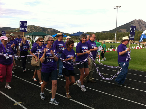 Walkers participate in the survivors lap at the July 20 Relay for Life in Estes Park.
