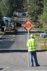 Traffic was slowed Monday morning on Columbine Avenue as crews repaired the road. The work on Columbine was part of a bigger project of road repair brought about by heavy rains earlier in July.