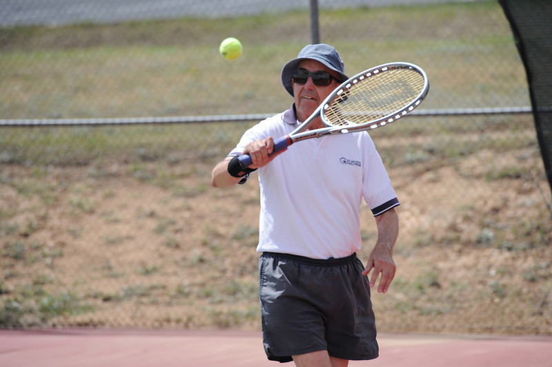 Walt Hester | Trail-Gazette<br /> Bob Benight of Estes Park takes a swing at the tennis courts on Monday. Tennis players had to shovel and sweep the courts to play.
