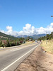 Clouds hang over the Continental Divde west of Estes Park Monday morning. Skies were mostly clear during the morning but additional rain was possible later in the day.