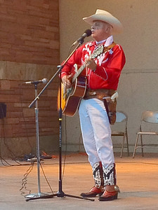 Cowboy singer Ron Ball entertains the crowd at Performance Park on Monday night. The performance was a sort of early start to Rodeo Week in Estes Park.