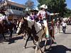 2012 Rooftop Rodeo queen Alex Hyland waves to th crowd Tuesday morning during the annual parade that kicks off rodeo week in Estes Park.
