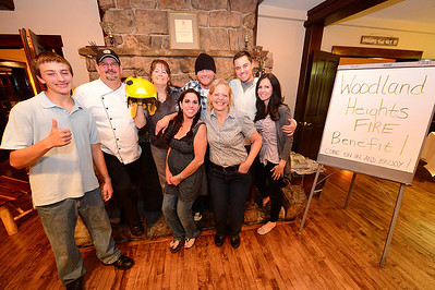 Walt Hester | Trail-Gazette Organizers of the Mary's Lake Lodge Woodland Heights Fire Benefit come together at the end of Saturday night's event. The benefit raised $600 for fire victims.