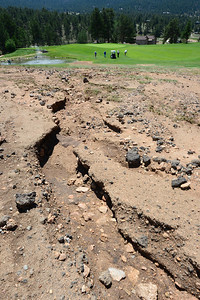 Walt Hester | Trail-Gazette Heavy rain over the weekend washed dirt and asphalt down the 10th fairway at the public 18-whole course. The EVRPD had a busy day scraping mud and repairing sandtraps at the course.