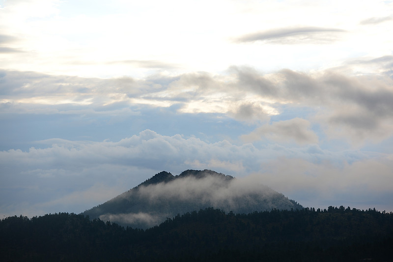 Walt Hester | Trail-Gazette<br /> Cloud drift around and over Mount Olympus on Saturday. several days of rain have reset the look of sunrise in Estes Park.