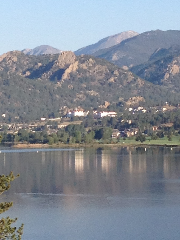 The Stanley Hotel gleams and reflects off of Lake Estes Wednesday morning. We should be clear and sunny most of the day with a slight Chance of afternoon showers and a high near 80.