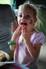 Walt Hester | Trail-Gazette<br /> Abigail Watry, 3, cleans off her hands, the all-natural way at the annual picnic. On top of food and games, face paintingf was available for kids of all ages.