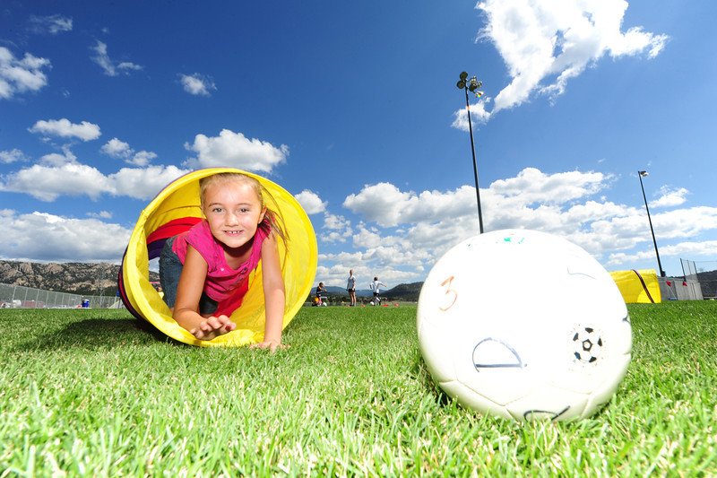 Walt Hester | Trail-Gazette<br /> Maya Kiser of Estes Park chasesher soccer ball through a tube during drills at soccer camp on Tuesday. The Estes Valley Recreation and Parks District camp runs through Friday.