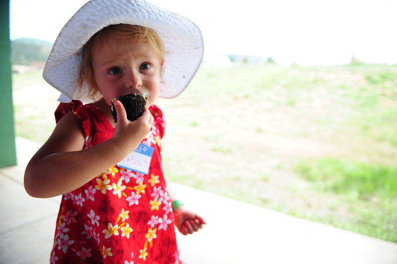 Walt Hester | Trail-Gazette<br /> Natalie Parker, 2, enjoys a cupcake at the New Life Center's annual picnic on Saturday. What the picnic lacked in sunshine, it more than made up in food.