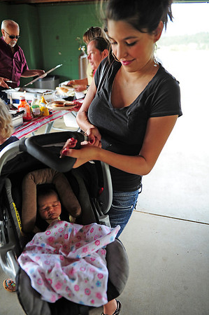 Walt Hester | Trail-Gazette<br /> Alexandria Vigil hefts her two-week-old daughter, Natalie at the New Life Center picnic. The pair constituet two generations of people born at the Estes Park Medical Center.