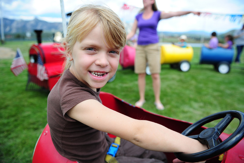 "Walt Hester | Trail-Gazette<br /> Savannah Stanalane, 6, of Abilene, Texas, enjoys a ride in a ""bucket"" train at Stanley Park on Friday. The event was part of the Estes Valley Public Library's Story Time."