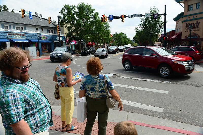 Walt Hester | Trail-Gazette<br /> Pedestrians await their turn at the corner of Elkhorn and Moraine avenues on Thursday.