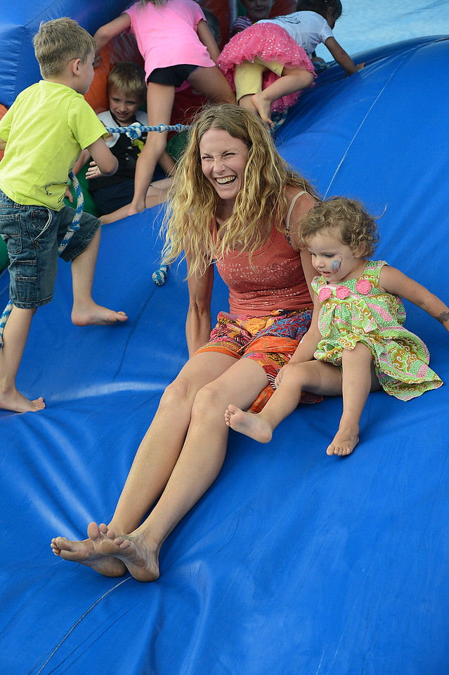 Walt Hester | Trail-Gazette<br /> Joanne Helmuth and daughter Elle, 2, enjoy the bouncy castle at the annual New Life Center Picnic on Saturday. The event celebrates all of the children born at the Estes Park Medical Center.