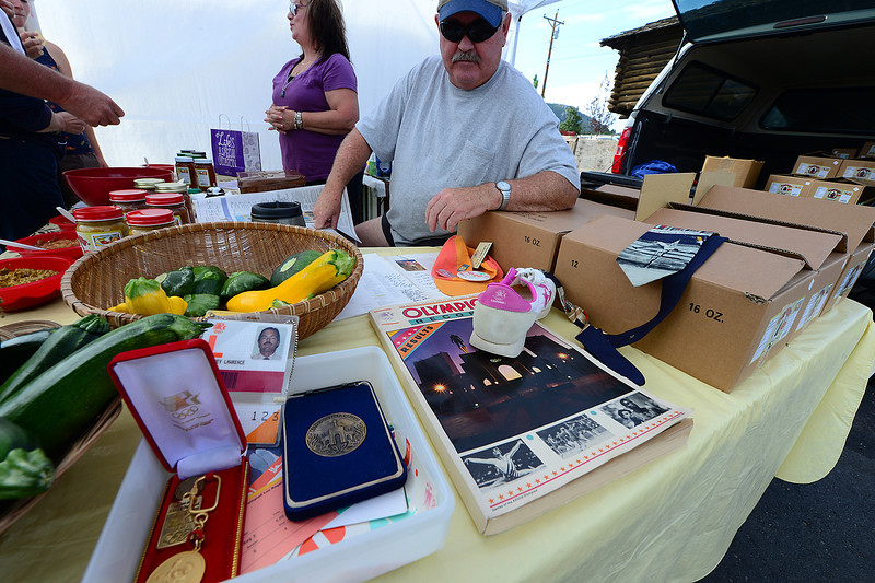 Walt Hester | Trail-Gazette<br /> Retired teachers Jeff and Kevin Lawrence sell salsa at the Estes Valley Farmers Market on Thursday. Jeff was a volunteer at the 1984 Los Angeles summer games and brought some of his memorabilia.