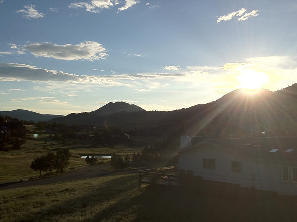 The sun clears the foothills east of Estes Park on Tuesday. Estes Park can expect a carbon copy of Monday; sunny in the morning with clouds and rain in the afternoon.